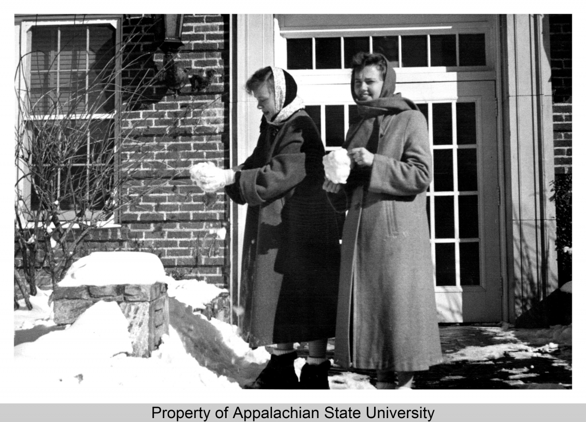 Description This image shows two students making snowballs after a snowfall at Appalachian State Teachers College (1929-1967) in the 1950s. Two women in winter coats can be seen standing outside what is likely Watauga County Hospital, built 1932 and later renamed Founders Hall, holding balls of snow.