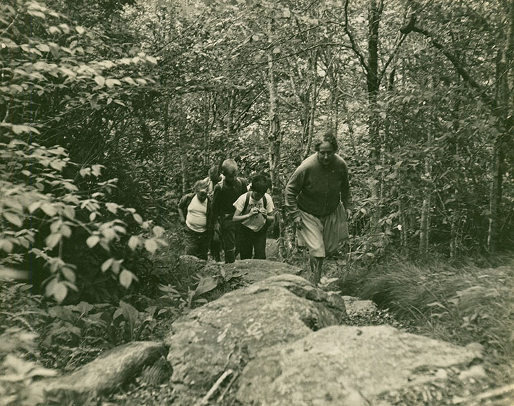 Vera Lachmann leads campers on a hiking trail