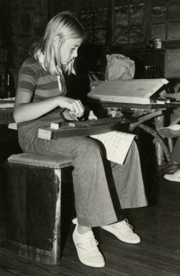 Girl playing a dulcimer