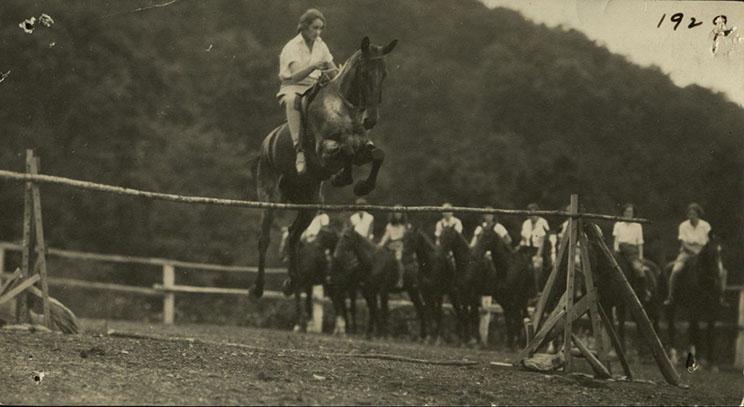 Jumping horses at Camp Yonahlossee