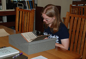 Researcher looking at a rare book