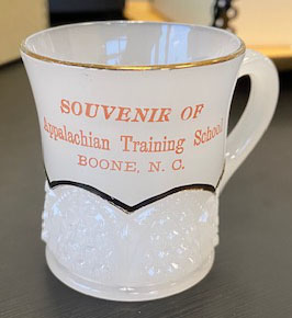 Souvenir milk cup from Appalachian Training School (1903–1925)