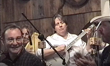 Still image of John Turner (left) and the Old Time Tradition band in the background.